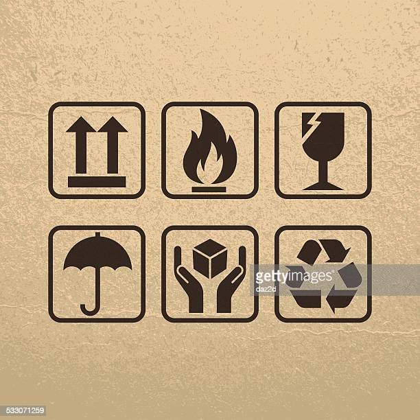 fragile symbols on brown paper texture - fragile sign stock illustrations