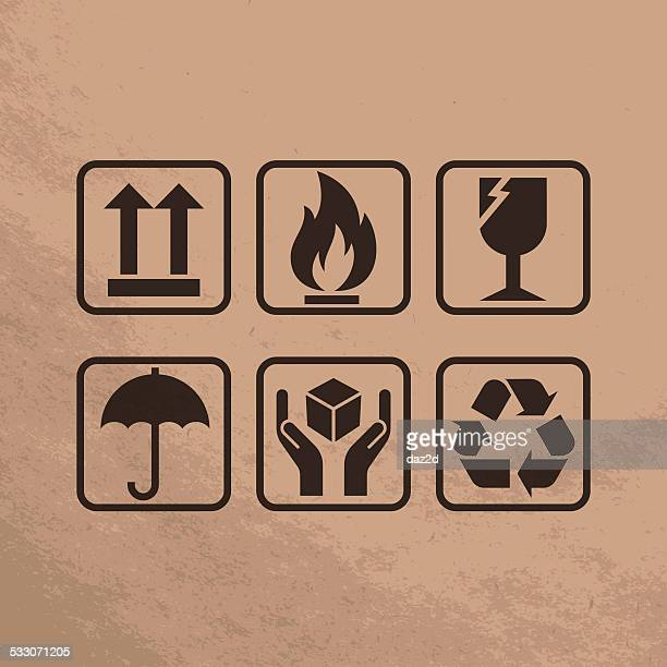 fragile symbols on brown paper - fragile sign stock illustrations