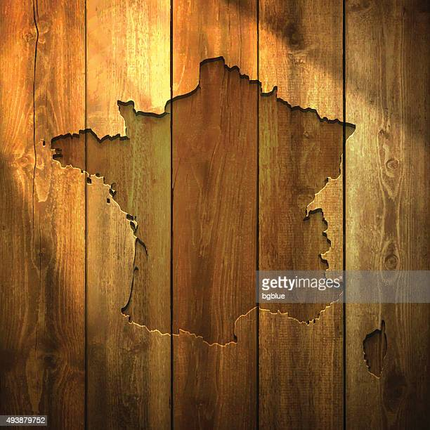 france map on lit wooden background - corsica stock illustrations, clip art, cartoons, & icons