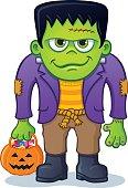 Frankenstein Monster Holding Pumpkin Pail