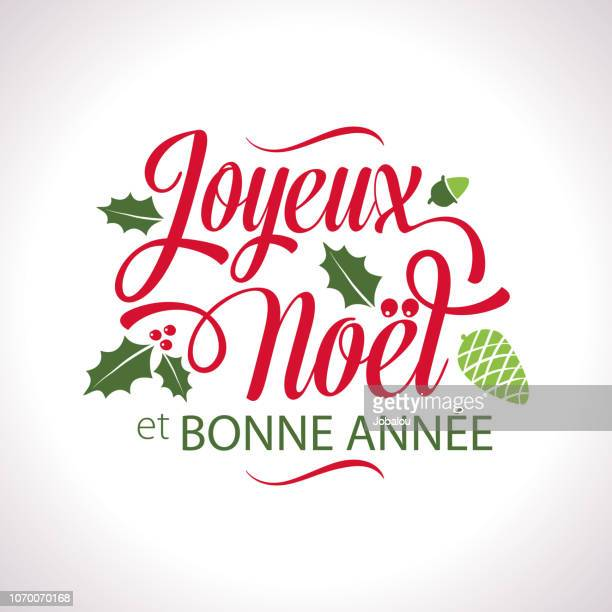 french christmas joyeux noël lettering text - french culture stock illustrations