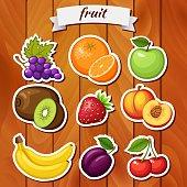 Fresh fruit on wooden background. Fruit icon. Fruit sticker. Vegan food. Grape, orange, apple, kiwi, strawberry, peach, banana, plum, cherry