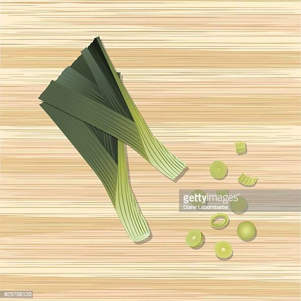 fresh vegetables: whole and sliced leeks on wood - leek stock illustrations, clip art, cartoons, & icons