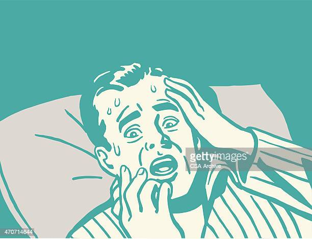Frightened Man in Bed