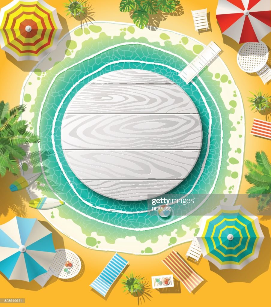 From above wooden circle emblem in water on beach with umbrellas.