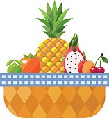 Fruit basket isolated (persimmon, pineapple, dragon fruit, peach and cherry).