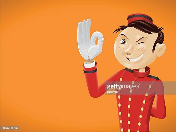 Funny bellboy doing OK sign