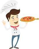 Funny chef serving pizza dish in the kitchen