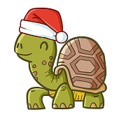 funny crawling turtle wearing Santa's hat for Christmas and smiling