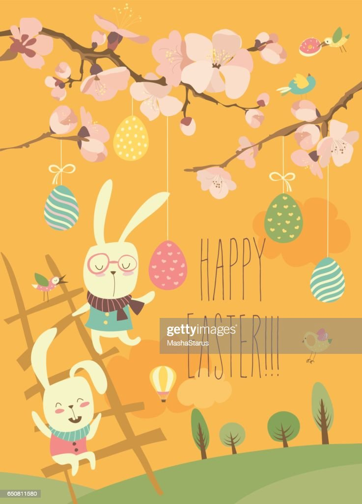 Funny easter bunnies with flowering branches