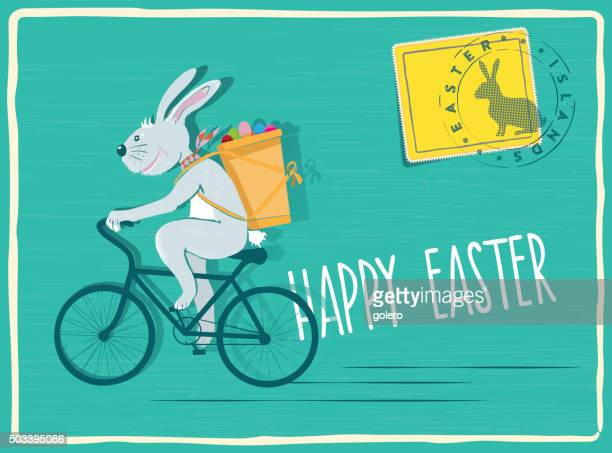 funny easter bunny biking with pannier filled with easter eggs - easter bunny stock illustrations