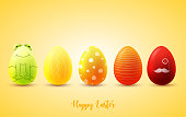 Funny Easter eggs on yellow sunny background