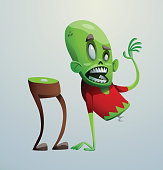 Funny green zombie fell apart into two parts