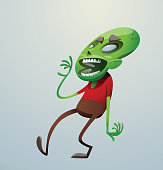 Funny green zombie walking to the left and laughing