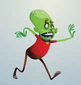 Funny green zombie walking to the right and smiling