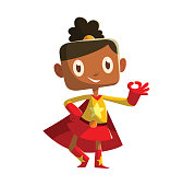 Funny little girl in a yellow-red superhero costume