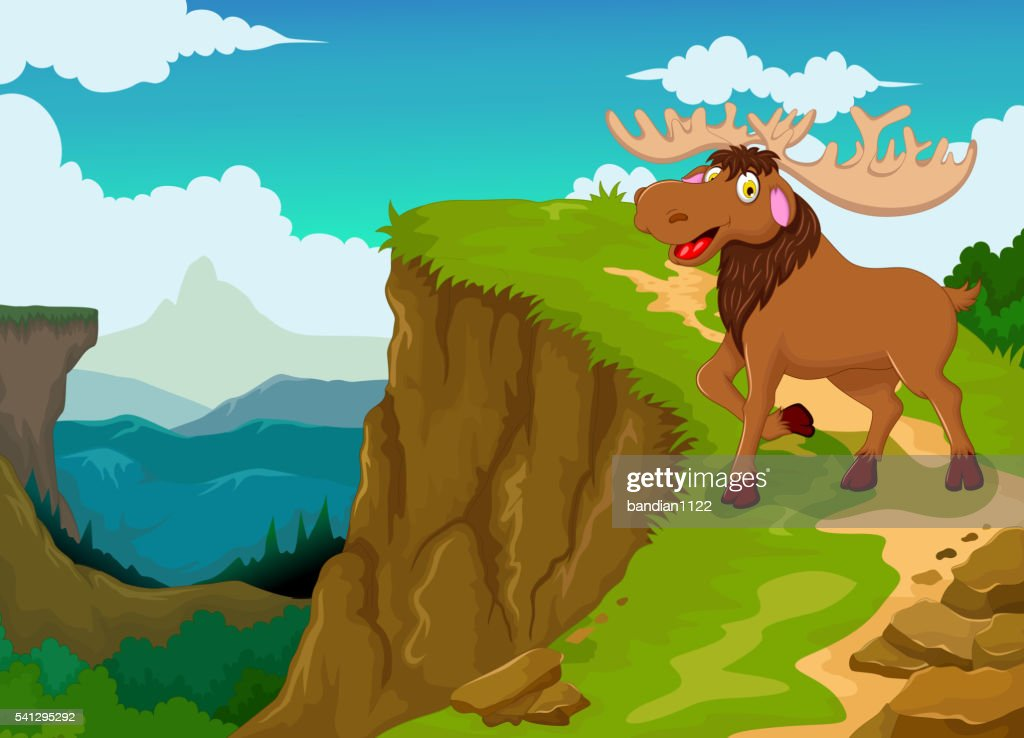 funny moose with mountain cliff landscape background