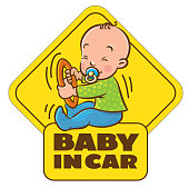Funny small baby sitting with dummy