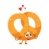 Funny soft and crispy German pretzel character with smiling face