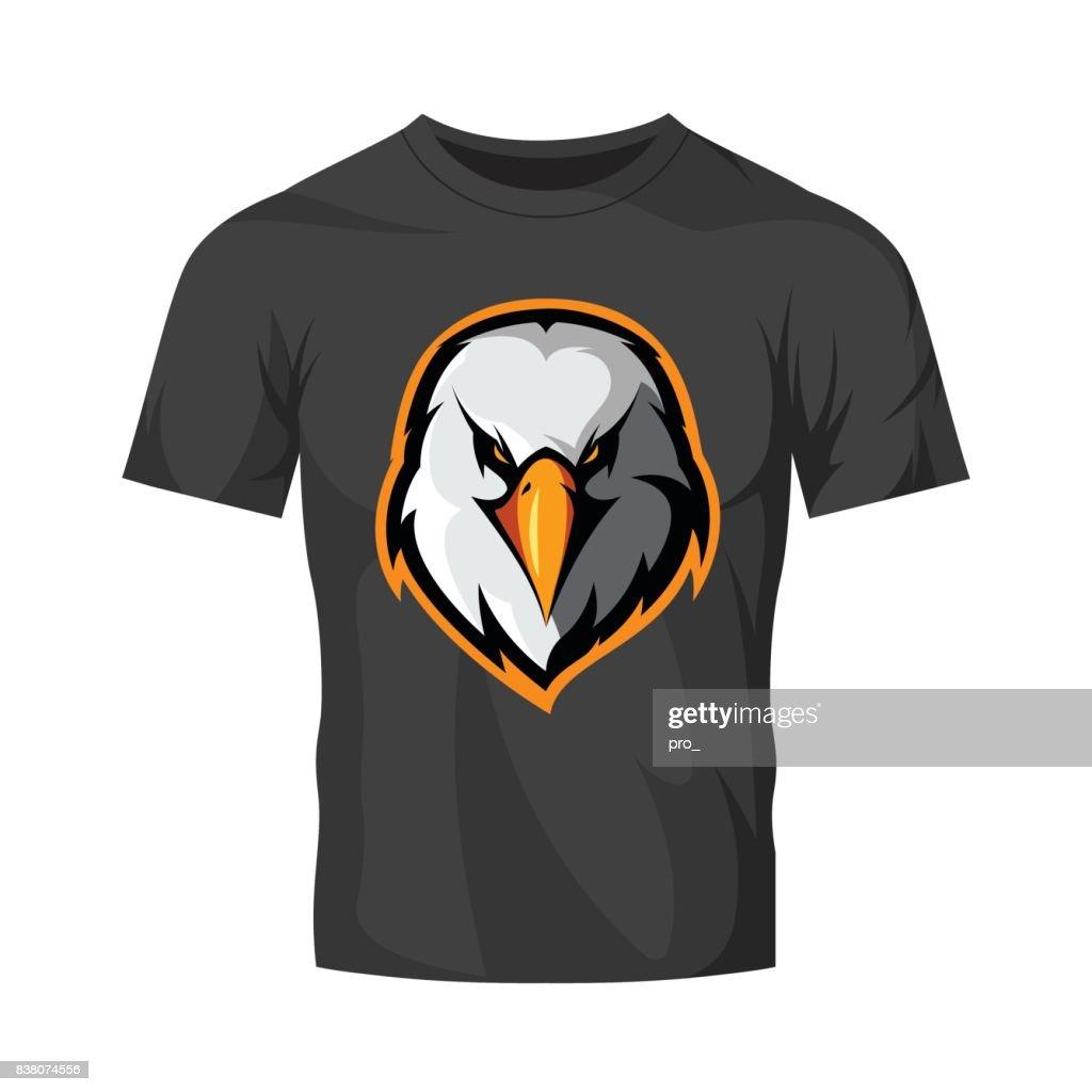 Furious eagle head athletic club vector logo concept isolated on black t-shirt mockup.