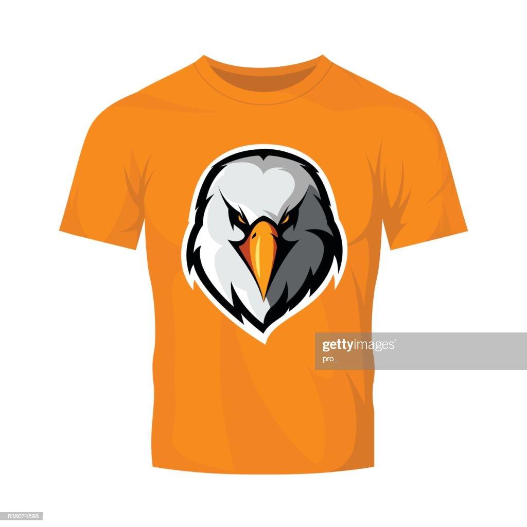 Furious eagle head athletic club vector logo concept isolated on orange t-shirt mockup.