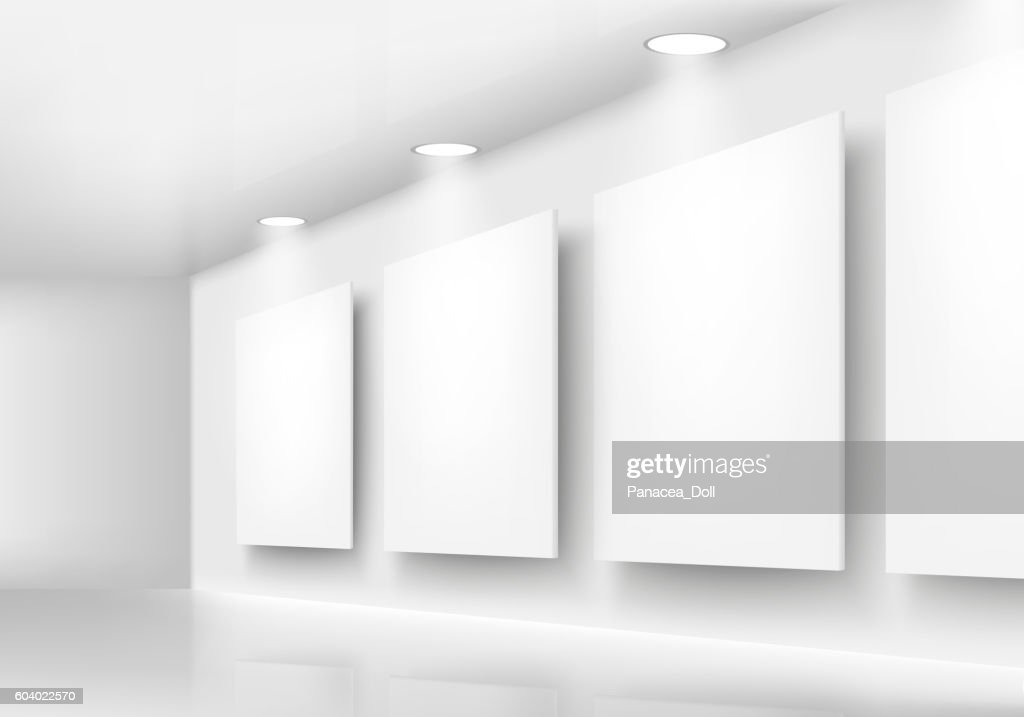 Gallery of empty frames on wall with lighting