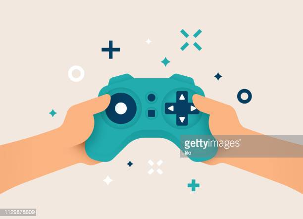 gamer mit gaming-controller - kontrolle stock-grafiken, -clipart, -cartoons und -symbole