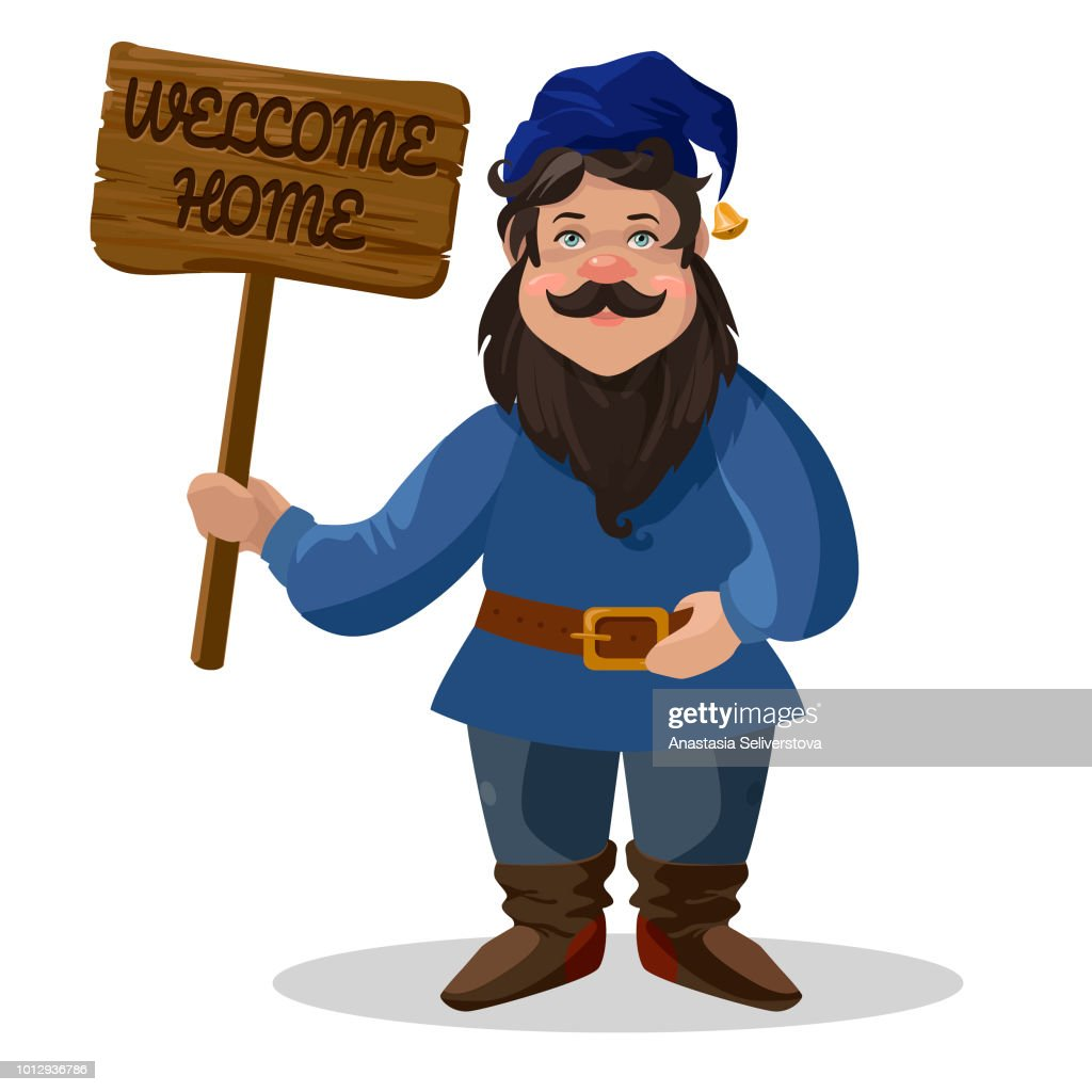 "Garden gnome with sign ""Welcome home""."