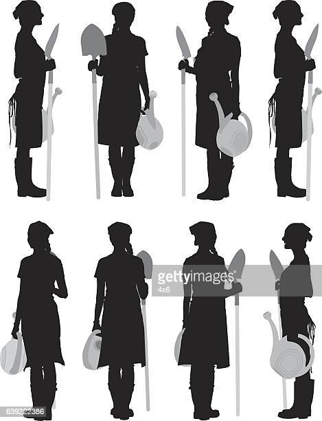 ilustrações, clipart, desenhos animados e ícones de gardener holding shovel and watering can - estereótipo de classe trabalhadora