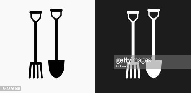 Gardening Spade and Fork Icon on Black and White Vector Backgrounds
