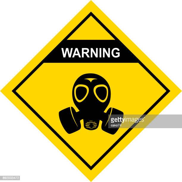 gas mask warning sign - radioactive contamination stock illustrations