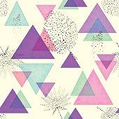 Geometric Seamless Pattern of Triangles on Light Yellow Background