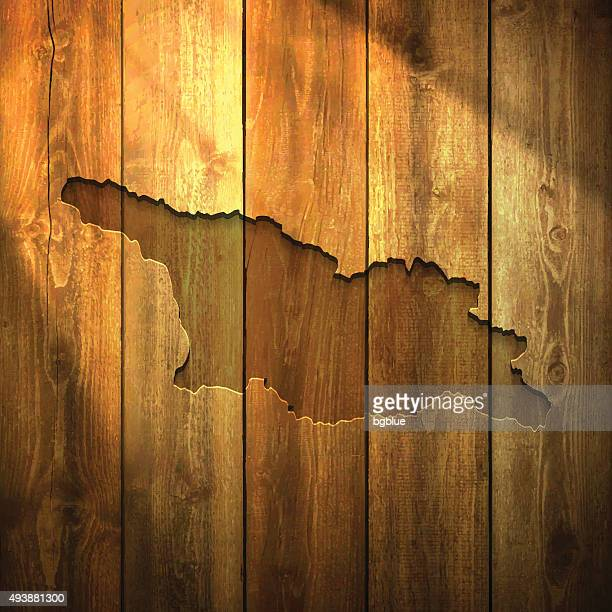 Georgia Map on lit Wooden Background