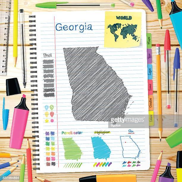 ilustraciones, imágenes clip art, dibujos animados e iconos de stock de georgia mapa dibujado a mano sobre cuaderno. fondo de madera - atlanta georgia