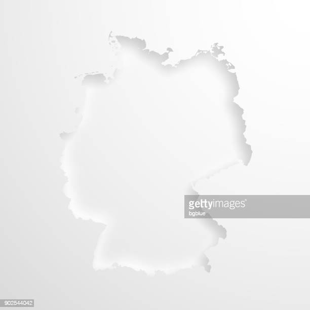 germany map with embossed paper effect on blank background - germany stock illustrations, clip art, cartoons, & icons