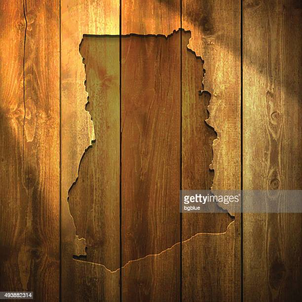 ghana map on lit wooden background - accra stock illustrations, clip art, cartoons, & icons
