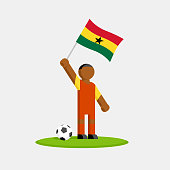 Ghana soccer player in kit with flag and ball