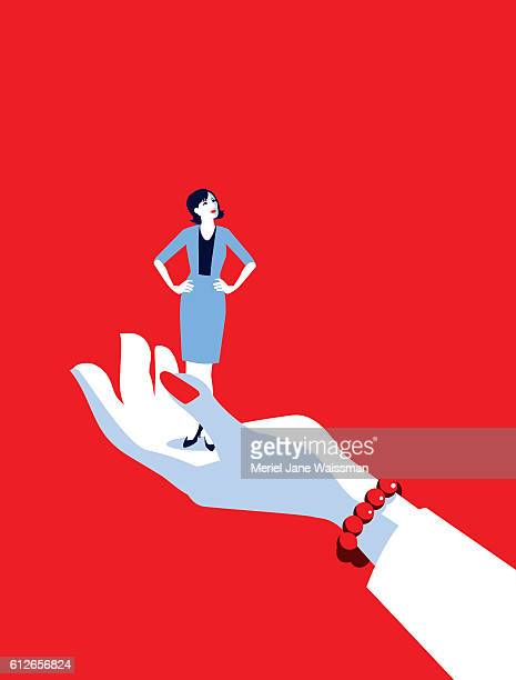 Giant Business Woman's Hand Holding Tiny Businesswoman