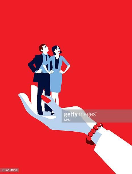 giant businesswoman's hand holding tiny businesswoman and man - guru stock illustrations, clip art, cartoons, & icons
