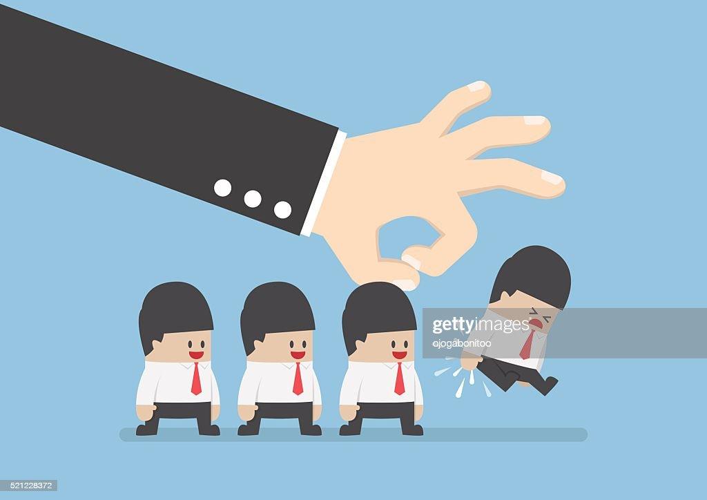 Giant hand flick businessman away