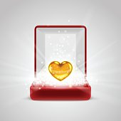 Gift box and gold heart in radiance