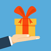 Gift box with a bow on his hand. Businessman, manager or seller proposes to take a gift for a holiday or birthday. Vector flat illustration.