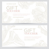 Gift voucher. Elegant festive gift coupon with gold flowers on a white background.