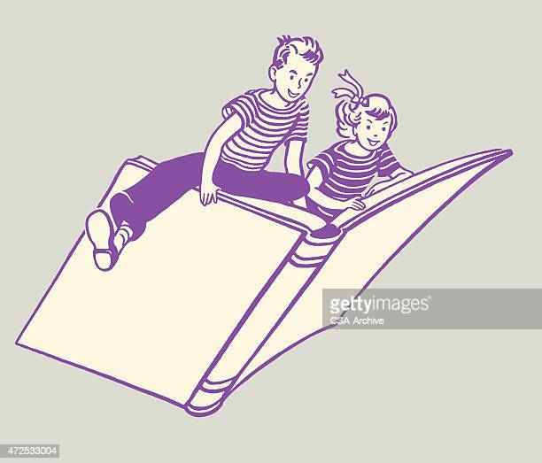 Girl and Boy Riding on Book