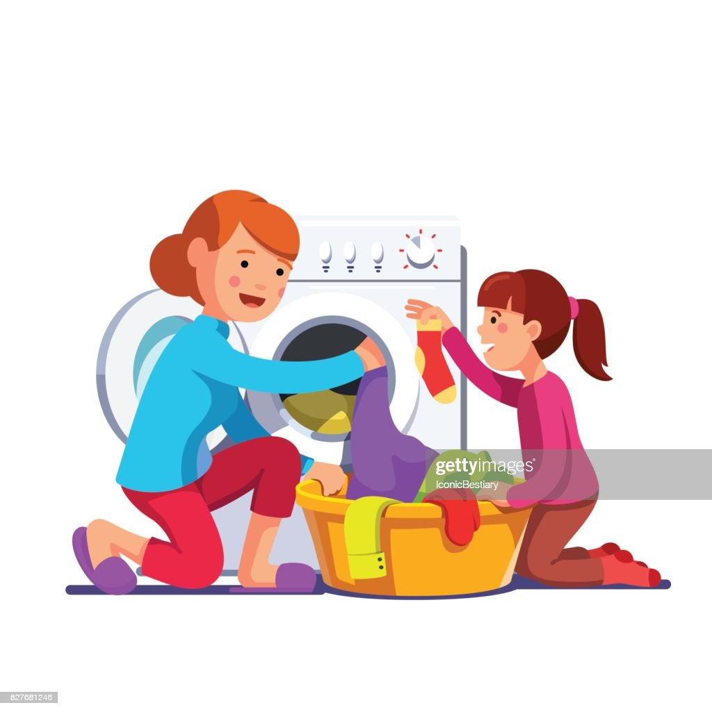 Girl help mum loading laundry to washing machine