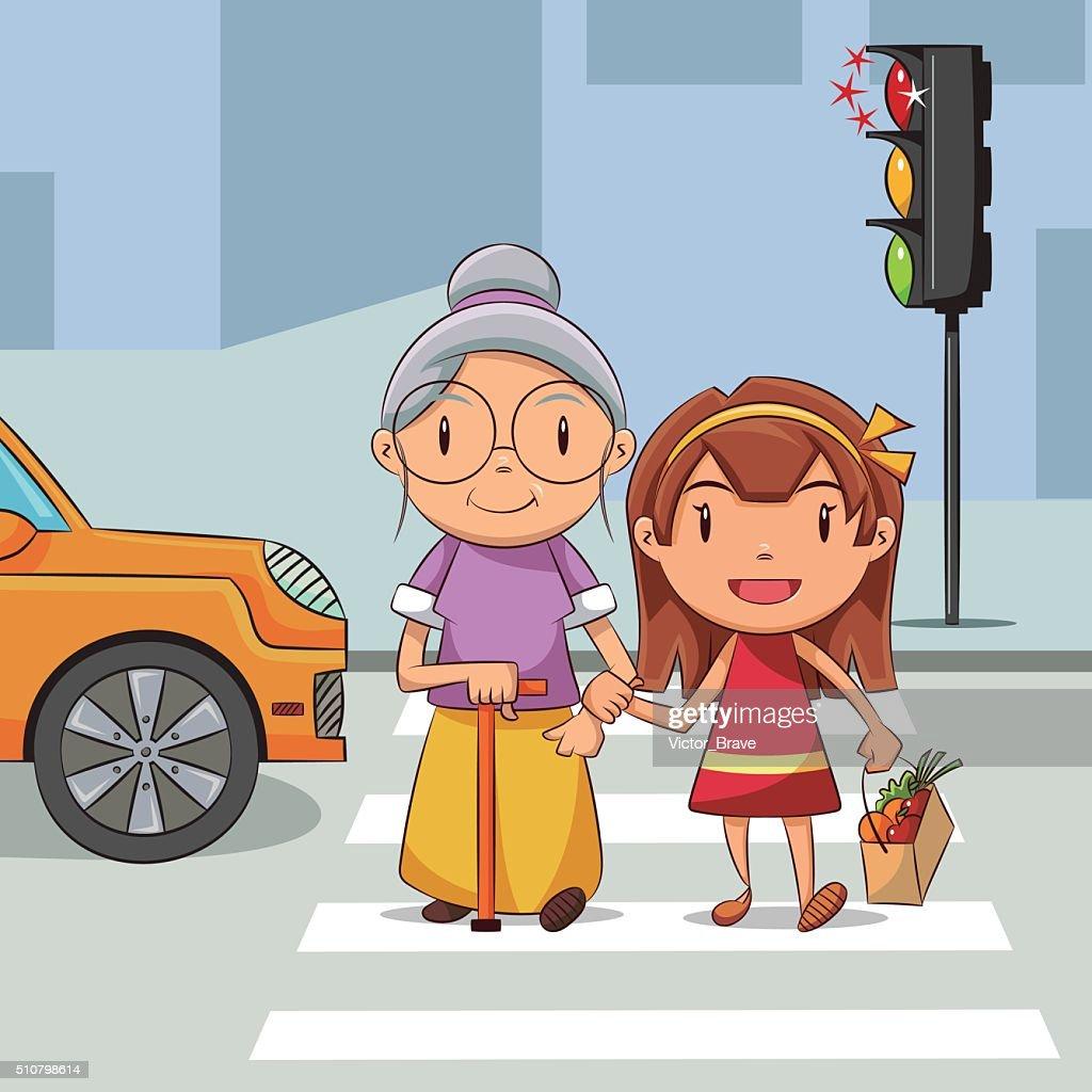 Girl helping old woman cross the street