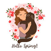 girl holding cat her arms spring