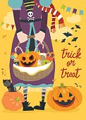Girl holding basket with pumpkin and sweets