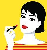 Girl holding lipstick