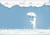 Girl holding umbrella under the rain in meadow, Paper cut, Paper art illustration background